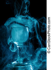 Aquamarine smoke in a glass. Halloween. - Abstract art....