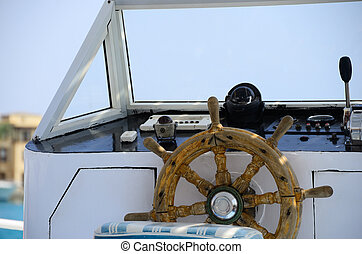 wooden steering wheel of boat holiday