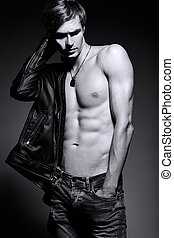 Young handsome muscled fit male model man in leather jacket...