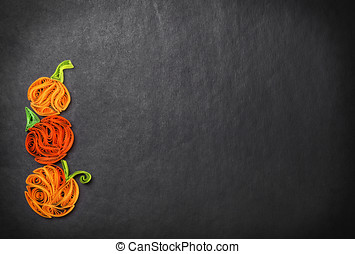 Quilling of pumpkins on a black background Halloween -...