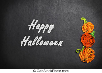 Quilling of pumpkins on a black background Halloween