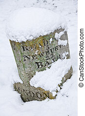 Vintage British Road Sign Covered In Winter Snow - A vintage...