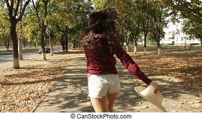 girl walking and fooling around