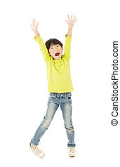 Happy little boy with arms up celebrating