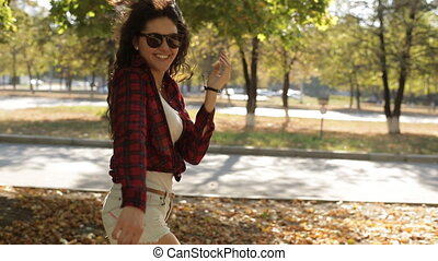 beautiful girl walking in the park and smiling