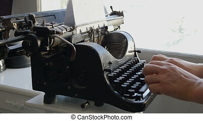 Man printing text with typewriter - Man printing text with...