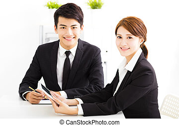 happy business man and woman working  in office