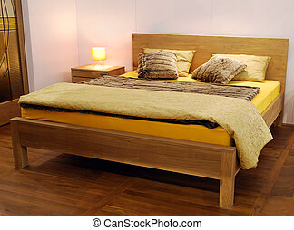 wooden bed - bedroom with wooden bed and wool