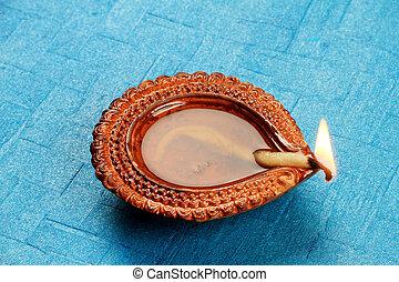 Hindu Festival Diwali Diya on Blue Background