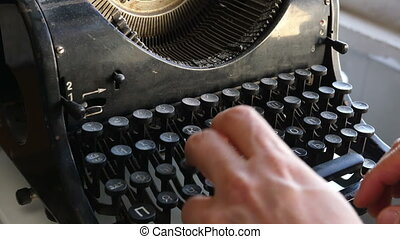 Man printing text with the broken cyrillic typewriter