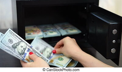 hand counts money - hand counts the money and puts them in a...