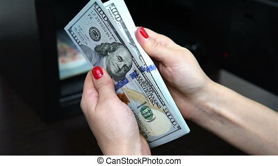 woman hand puts dollar bills - woman hand puts and closed...