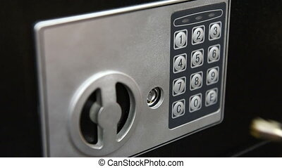 Woman hand opened safe - Woman hand opened electronic bank...