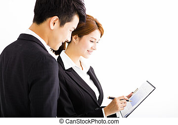 business partners looking at business document