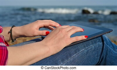 Woman with tablet - Woman with digital tablet at beach