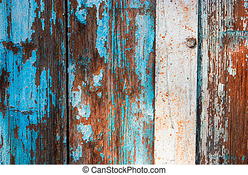 Weathered wood planks half painted in blue
