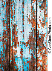 Weathered wood planks half painted in blue vertical image