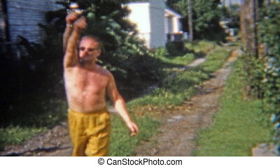 1965: Men playing horseshoes in the - Original vintage 8mm...