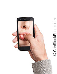 Hand holding mobile phone with lips sucking thumb