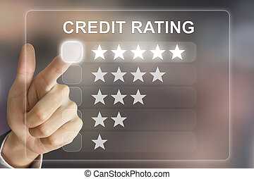 business hand pushing credit rating on virtual screen -...
