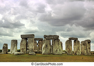 Stonehenge historic site under dramatic sky. Stonehenge is a...
