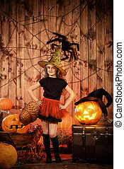 pretty sorcery - Pretty little girl witch posing with...