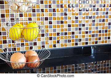 Vegetable rack - Wire vegetable rack in a kitchen with brown...