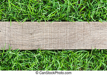 grain wood on green grass