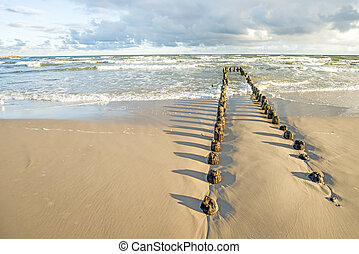 Baltic Sea with groynes and surf