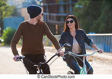 Couple on bicycles. Beautiful young couple riding bicycles...