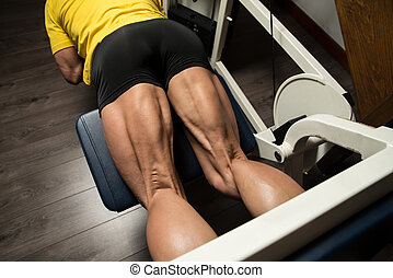 Sporty Legs Hamstrings - Bodybuilder Doing Heavy Weight...