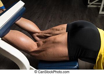 Exercise For Legs Hamstrings - Bodybuilder Doing Heavy...