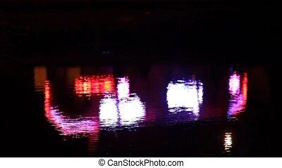Reflection Of Multicolored Flash Lights On Water