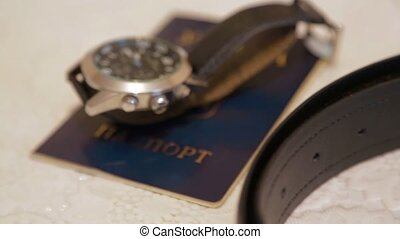 Man's Passport, Watch And Belt On Table