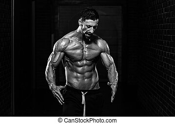 Fit Man Showing His Well Trained Body - Portrait Of A...