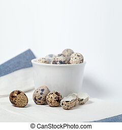 Quail eggs still life on wite tablecloth