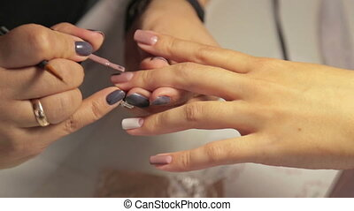 Manicurist working with woman nails