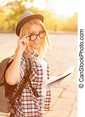 Cheerful girl holding map - Follow me Positive vivacious...