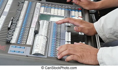 Hand Adjusting Audio Mixer - Professional audio mixing...