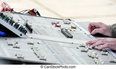 Mixing Music On Music Console - Part of an audio sound mixer...