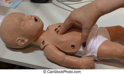 Heart massage on child mannequin - Womans hand doing cardiac...