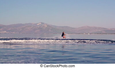 Wakeboarder - Young Man Wakeboarding Jump On Summer...