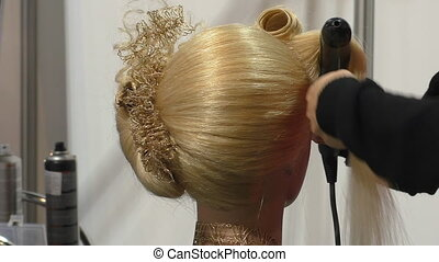 Hair design,curl making - Hair designer or stylist is making...