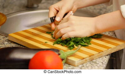 Woman making a salad with fresh vegetables - Young woman...