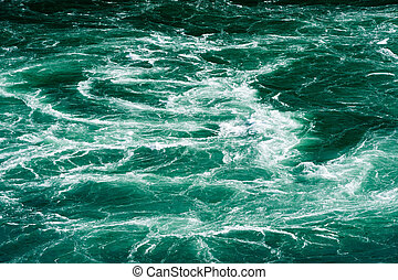 Abstract white water currents in green river - Abstract...