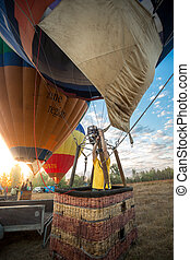 pilot using gas heater to take off in hot air balloon -...
