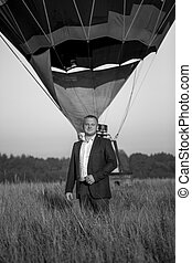 Black and white photo of businessman posing against air...