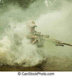 crossing the river - Member of Navy SEAL Team crossing the...