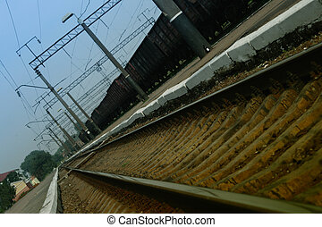 Railway station under an inclination with a freight train