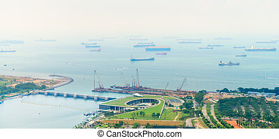 Many Commercial Cargo Ships Moored in a Harbor - Many...